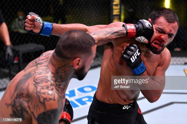 Daniel Rodriguez punches Gabe Green in their welterweight fight during the UFC Fight Night event at UFC APEX on May 30 2020 in Las Vegas Nevada