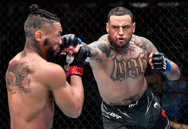 Daniel Rodriguez punches Kevin Lee in a welterweight fight during the UFC Fight Night event at UFC APEX on August 28, 2021 in Las Vegas, Nevada.
