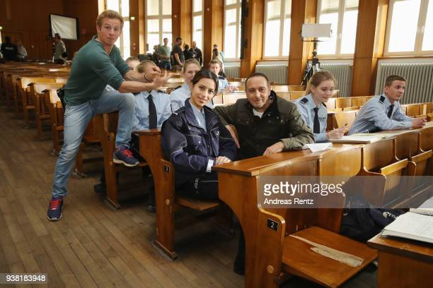 Daniel Roesner Gizem Emre and Erdogan Atalay are seen on set during the 'Alarm fuer Cobra 11' photocall on March 26 2018 in Cologne Germany