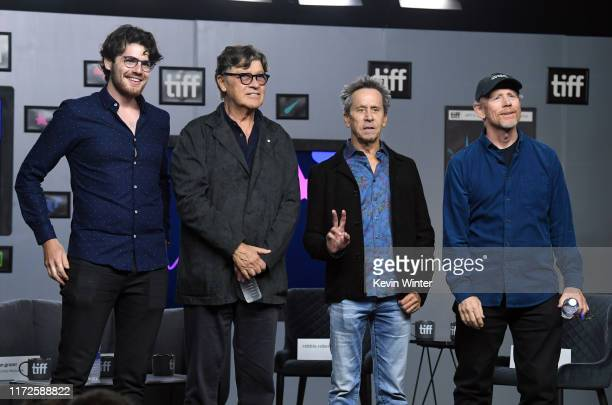 """Daniel Roher, Robbie Robertson, Brian Grazer, and Ron Howard attend the """"Once Were Brothers: Robbie Robertson and the Band"""" press conference during..."""