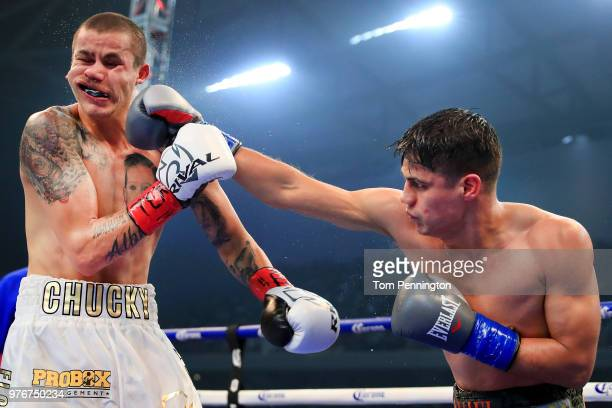 Daniel Roman lands a punch against Moises Flores in the seventh round of a WBA Super Bantamweight Championship bout at The Ford Center at The Star on...