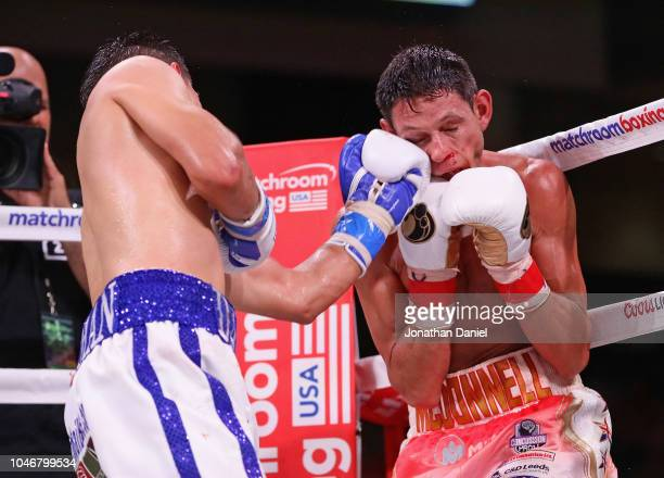 Daniel Roman lands a punch on Gavin McDonnell in a WBA World Super-Bantamwieght title match at Wintrust Arena on October 6, 2018 in Chicago, Illinois.