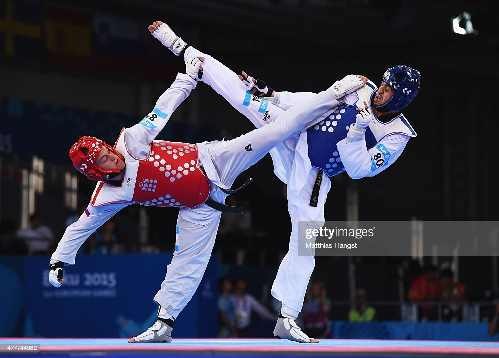 Daniel Ros Gomez of Spain (blue) and Ivan Konrad Trajkovic of Slovenia (red) compete in the Men's +80kg Taekwondo bronze medal final during day seven of the Baku 2015 European Games at the Crystal Hall on June 19, 2015 in Baku, Azerbaijan.