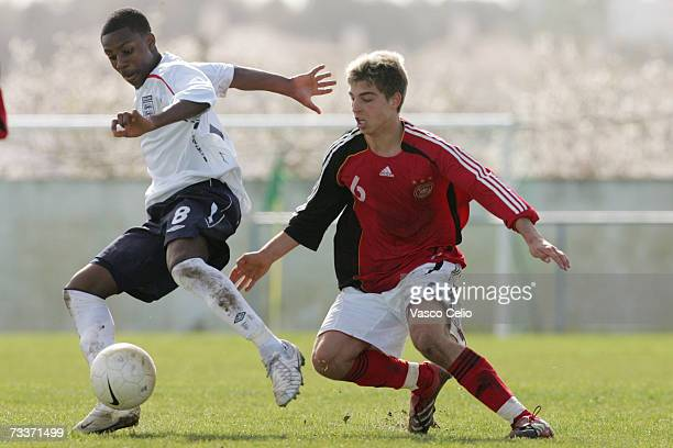 Daniel Rose of England vies for the ball with Kevin Wolze of Germany during the Men's U17 international Tournament match between Englad and Germany...