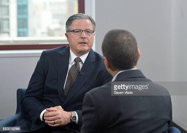 Daniel Roth Executive Editor of LinkedIn interviews John Watson CEO Of Chevron at LinkedIn on May 17 2016 in New York City