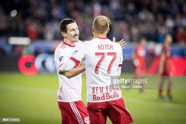 Daniel Royer of New York Red Bulls celebrates with Captain Sacha Kljestan of New York Red Bulls after kicking a goal during the MLS match between New...