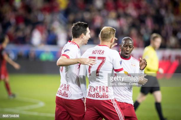 Daniel Royer of New York Red Bulls celebrates with Captain Sacha Kljestan of New York Red Bulls and Bradley WrightPhillips of New York Red Bulls...