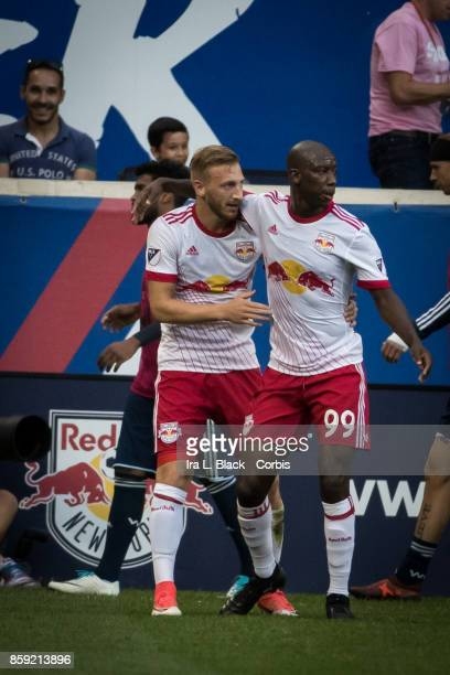 Daniel Royer of New York Red Bulls gets congratulated by Bradley WrightPhillips of New York Red Bulls during the MLS match between New York Red Bulls...