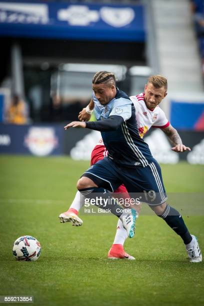 Daniel Royer of New York Red Bulls goes in for the ball against Erik Hurtado of the Vancouver Whitecaps FC during the MLS match between New York Red...