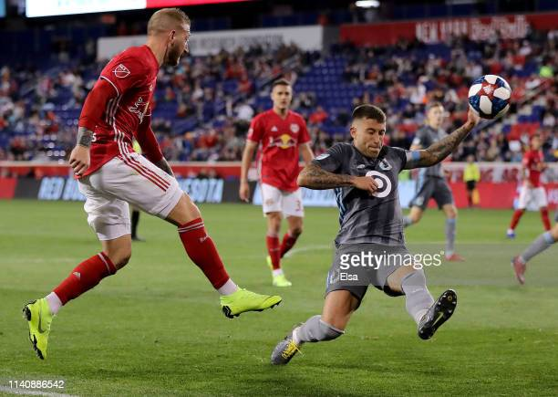 Daniel Royer of New York Red Bulls takes a shot as Francisco Calvo of Minnesota United defends in the second half at Red Bull Arena on April 06, 2019...
