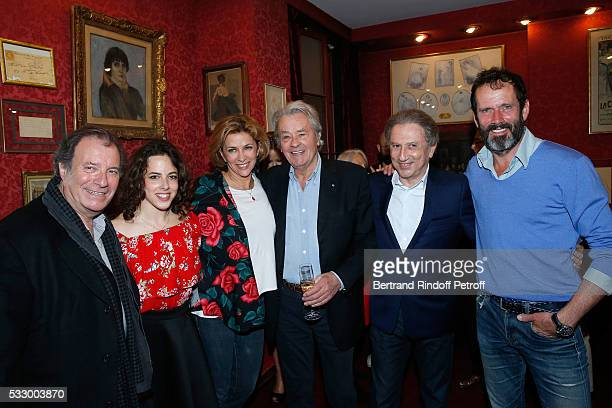 "Daniel Russo, Fanny Guillot, Corinne Touzet, Alain Delon, Michel Drucker and Christian Vadim attend the 100th representation of the Theater piece ""Un..."