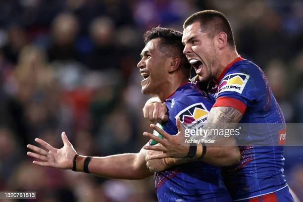 Daniel Saifiti and David Klemmer celebrate a try during the round 12 NRL match between the Newcastle Knights and the Manly Sea Eagles at McDonald...