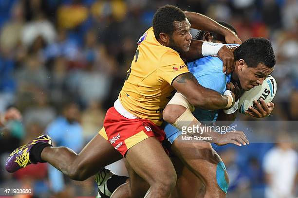 Daniel Saifiti of Fiji is tackled during the International Test Match between Fiji and Papua New Guinea at Cbus Super Stadium on May 2, 2015 on the...