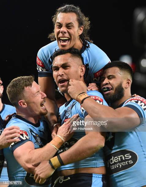 Daniel Saifiti of the Blues celebrates after scoring a try during game one of the 2021 State of Origin series between the New South Wales Blues and...