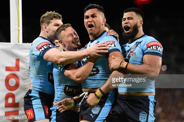 Daniel Saifiti of the Blues celebrates with team mates after scoring a try during game one of the 2021 State of Origin series between the New South...
