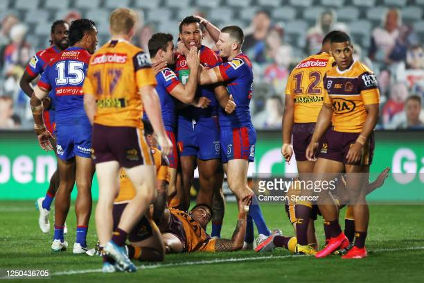 Daniel Saifiti of the Knights celebrates scoring a try during the round six NRL match between the Newcastle Knights and the Brisbane Broncos at...