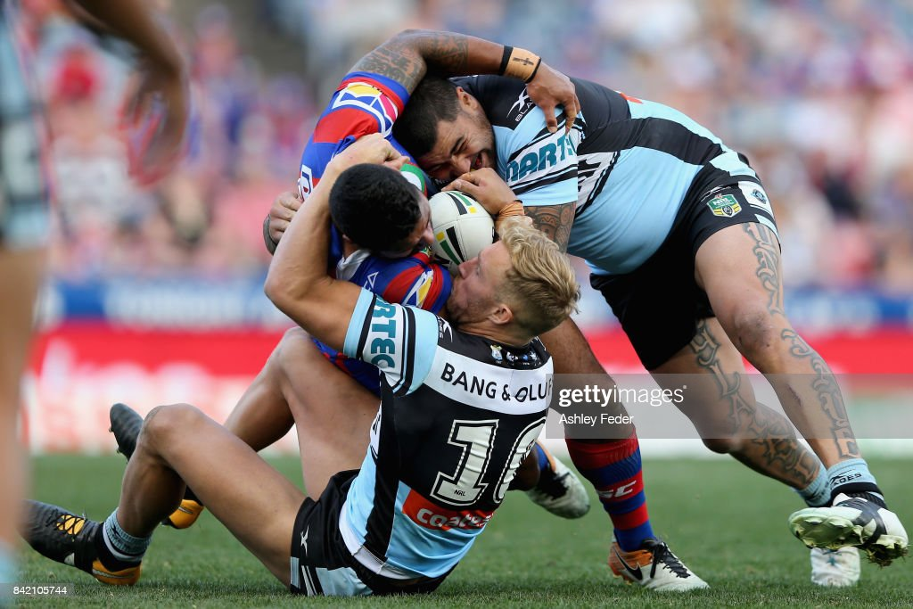 Daniel Saifiti of the Knights is tackled by Andrew Fifita of the Sharks during the round 26 NRL match between the Newcastle Knights and the Cronulla Sharks at McDonald Jones Stadium on September 3, 2017 in Newcastle, Australia.