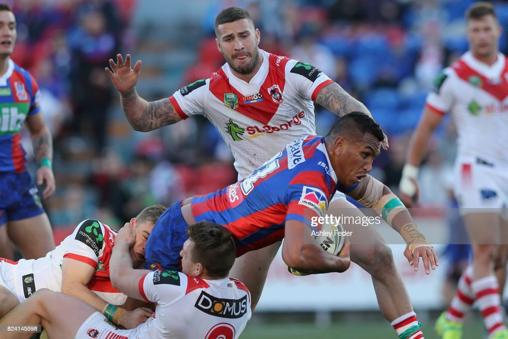 Daniel Saifiti of the Knights is tackled by the Dragons defence during the round 21 NRL match between the Newcastle Knights and the St George Illawarra Dragons at McDonald Jones Stadium on July 29, 2017 in Newcastle, Australia.
