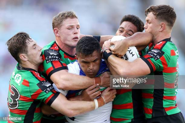 Daniel Saifiti of the Knights is tackled during the NRL Elimination Final match between the South Sydney Rabbitohs and the Newcastle Knights at ANZ...