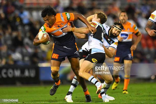 Daniel Saifiti of the Knights is tackled during the round 22 NRL match between the Cronulla Sharks and the Newcastle Knights at Moreton Daily...