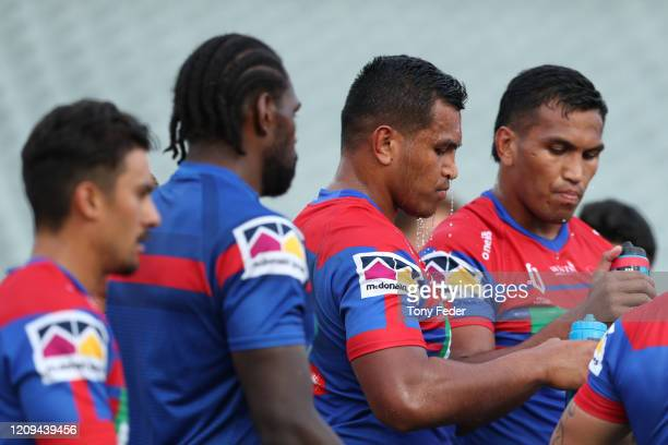Daniel Saifiti of the Knights takes a drink in the warm up before the start of the game during the NRL trial match between the Sydney Roosters and...