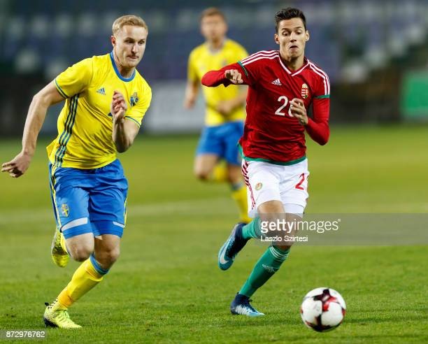 Daniel Salloi of Hungary U21 competes for the ball with Franz Brorsson of Sweden U21 during the UEFA Under 21 Euro 2019 Qualifier match between...