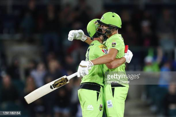 Daniel Sams and Chris Green of the Thunder celebrate victory over the Heat during the Big Bash League match between the Sydney Thunder and the...