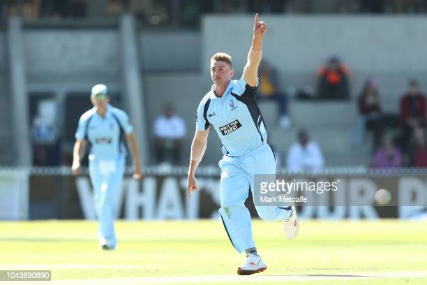 Daniel Sams of the Blues celebrates taking the wicket of Sam Heazlett of the Bulls during the JLT One Day Cup match between New South Wales and...