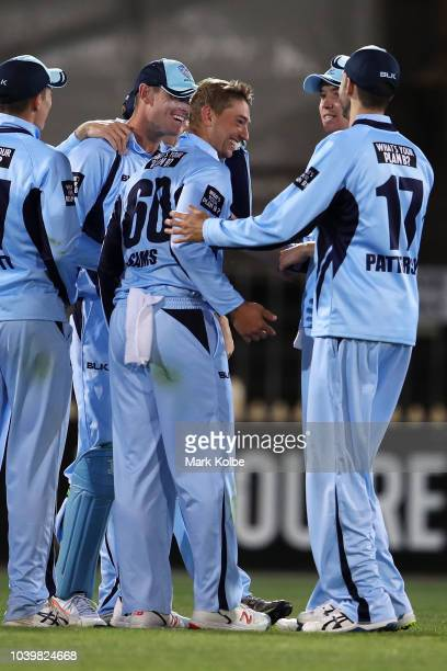 Daniel Sams of the NSW Blues celebrates taking the wicket of George Bailey of the Tigers during the JLT One Day Cup match between New South Wales and...