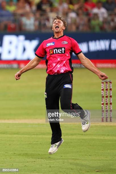 Daniel Sams of the Sixers celebrates taking the wicket of Jos Buttler of the Thunder during the Big Bash League match between the Sydney Thunder and...