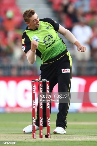 Daniel Sams of the Thunder celebrates after claiming the wicket of Cameron Boyce of the Renegades during the Big Bash League match between the Sydney...