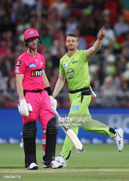 Daniel Sams of the Thunder celebrates after claiming the wicket of Jordan Silk of the Sixers during the Big Bash League match between the Sydney...