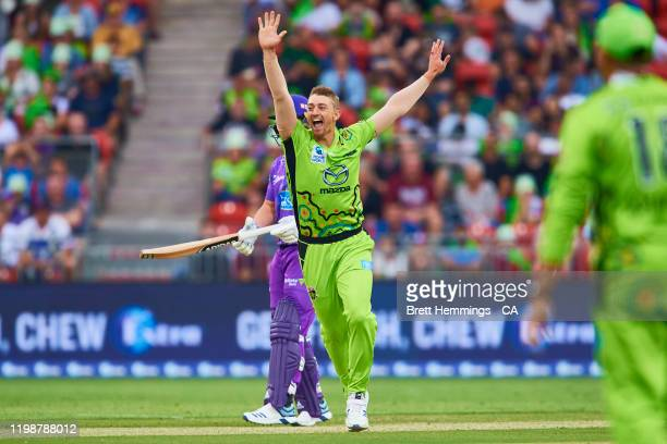 Daniel Sams of the Thunder celebrates after taking the wicket of George Bailey of the Hurricanes during the Big Bash League match between the Sydney...