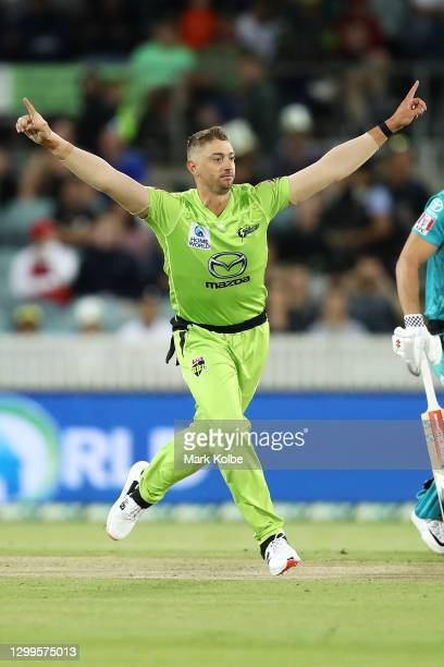 Daniel Sams of the Thunder celebrates taking the wicket of Joe Denly of the Heat during the Big Bash League match between the Sydney Thunder and the...