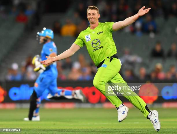 Daniel Sams of the Thunder celebrates the wicket of Phil Salt of the Strikers during the Big bash League Finals match between the Adelaide Strikers...
