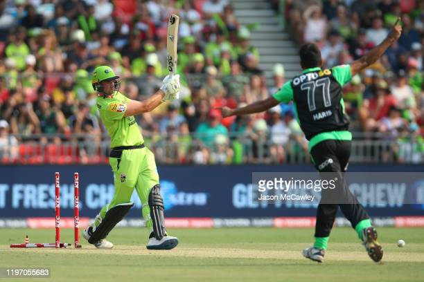 Daniel Sams of the Thunder is dismissed by Haris Rauf of the Stars during the Big Bash League match between the Sydney Thunder and the Melbourne...