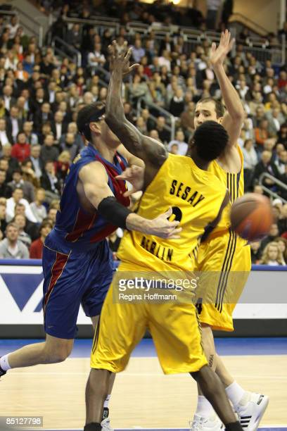 Daniel Santiago #25 of Regal FC Barcelona competes with Ansu Sesay #9 of Alba Berlin during the Euroleague Basketball Last 16 Game 4 match between...