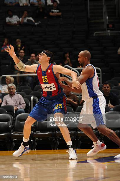 Daniel Santiago of Regal FC Barcelona calls for the ball in the post against Brian Skinner of the Los Angeles Clippers at Staples Center on October...