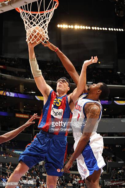 Daniel Santiago of Regal FC Barcelona has his shot challenged by DeAndre Jordan of the Los Angeles Clippers at Staples Center on October 19 2008 in...