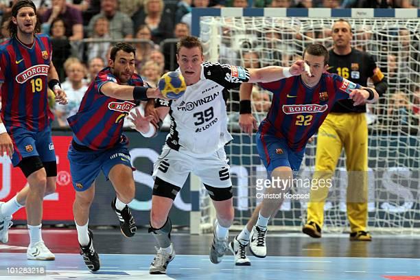 Daniel Sarmiento Melian of Barcelona Borges and Shiarei Rutenka of Barcelona fight for the ball against Filip Jicha of Kiel during the handball final...