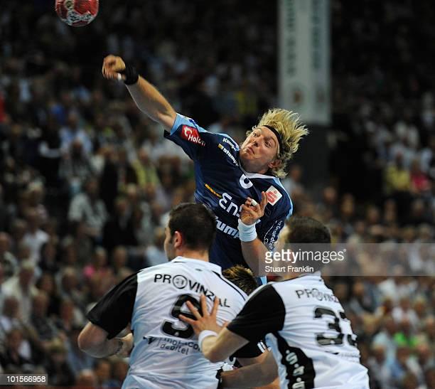 Daniel Sauer of Balingen is challenged by Ignor Anic and Dominik Klein of Kiel during the Toyota Handball bundesliga match between THW Kiel and HBW...