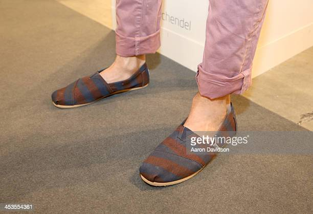 Daniel Schaeffer wearing TOMS shoes attends Art Basel Miami Beach 2013 at the Miami Beach Convention Center on December 4 2013 in Miami Beach Florida