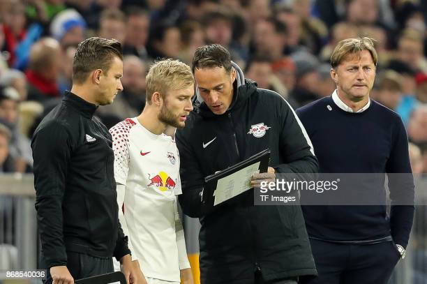 Daniel Schlager and head coach Ralph Hasenhuettl of Leipzig look on and Konrad Laimer of Leipzig speaks with goalkeeper coach Frederik Goessling of...