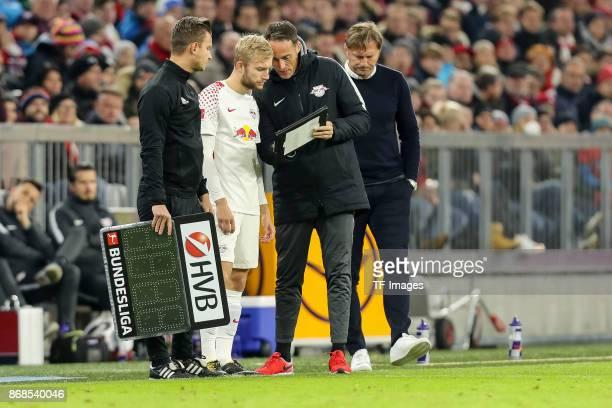 Daniel Schlager Konrad Laimer of Leipzig goalkeeper coach Frederik Goessling of Leipzig and head coach Ralph Hasenhuettl of Leipzig look on during...