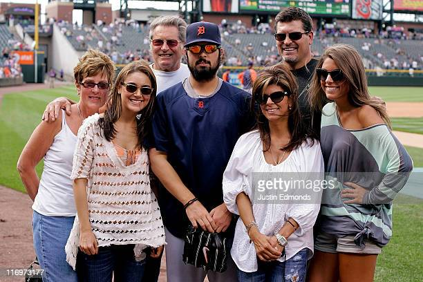 Daniel Schlereth of the Detroit Tigers poses for a picture with his family including former NFL player and current ESPN football analyst Mark...