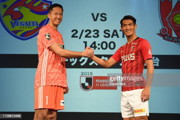 Daniel Schmidt of Vegalta Sendai and Tomoaki Makino of Urawa Red Diamonds shake hands during the JLeague Kick Off Conference on February 14 2019 in...
