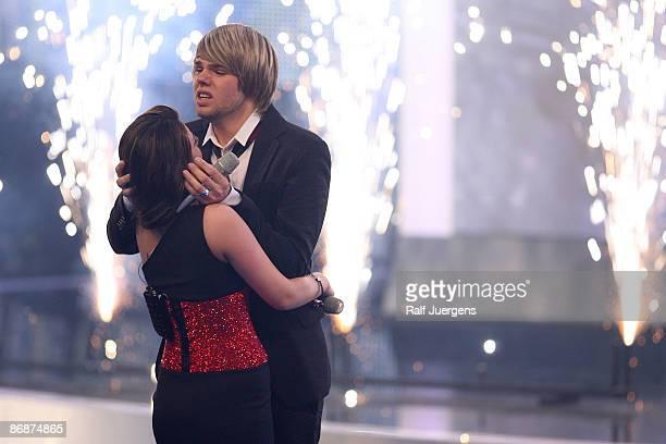 Daniel Schuhmacher hugs Sarah Kreuz as he wins the singer qualifying contest DSDS 'Deutschland sucht den Superstar' on May 02 2009 in Cologne Germany