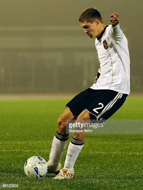 Daniel Schwaab of Germany scores the penalty goal during the UEFA U21 Championship match between San Marino and Germany at Olimpico stadium on...