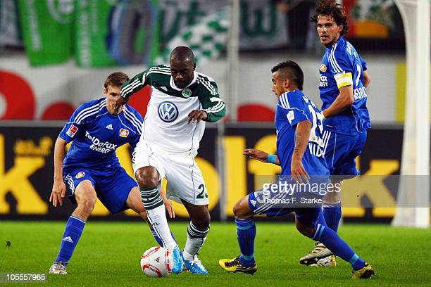 Daniel Schwaab of Leverkusen Grafite of Wolfsburg and Arturo Vidal and Manuel Friedrich of Leverkusen in action during the Bundesliga match between...