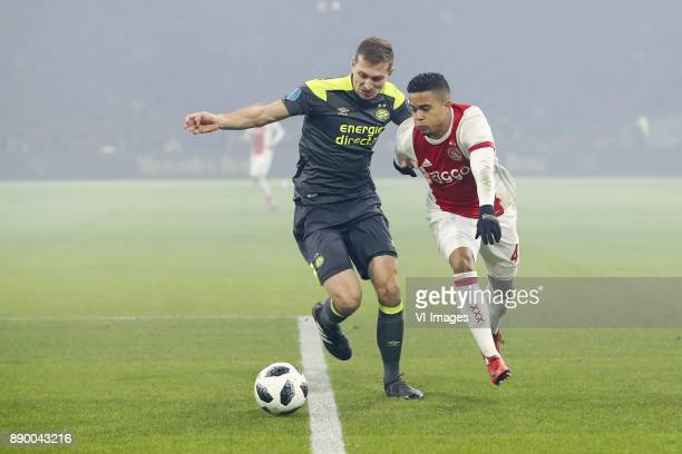 Daniel Schwaab of PSV Justin Kluivert of Ajax during the Dutch Eredivisie match between Ajax Amsterdam and PSV Eindhoven at the Amsterdam Arena on...
